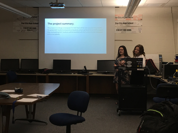 Anna Capps and Samantha Hatcher present their project.